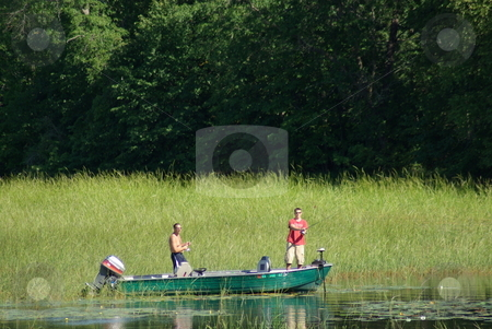 Fishing escape stock photo, Two fisherman try their luck lake fishing from a boat on a lazy summer afternoon in Minnesota. by Dennis Thomsen