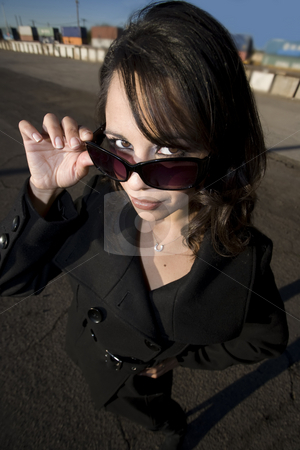 Beautiful Woman in a Trenchcoat stock photo, Beautiful woman in black trenchcoat and sunglasses at train yard by Scott Griessel