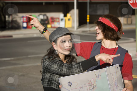 Lost Couple stock photo, Lost Young Couple on the Sidewalk with Map by Scott Griessel