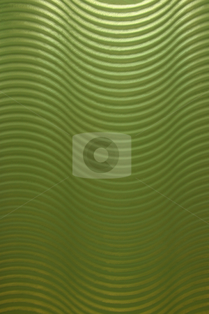 Wavy Glass stock photo, A green wavy abstract glass wall that makes a wonderful texture by Kevin Tietz