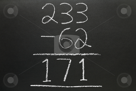 A basic subtraction sum written on a blackboard. stock photo, A basic subtraction sum written on a blackboard. by Stephen Rees
