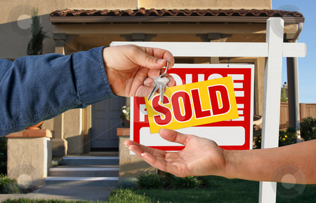 Handing Over the Keys to A New Home stock photo, Handing Over the Keys to A New Home with Sold Home For Sale Sign. by Andy Dean