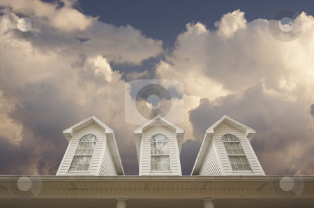 House Roof and Windows stock photo, House Roof and Windows Against a Cloudy Sky by Andy Dean