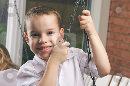 Adorable Young Boy Smiles stock photo, Adorable Young Boy with Blue Eyes Smiles for the Camera by Andy Dean