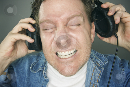 Shocked Man Wearing Headphones stock photo, Shocked Man Desperately Trying To Take Off His Headphones. by Andy Dean