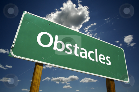 Obstacles Road Sign stock photo, Obstacles Road Sign with dramatic clouds and sky. by Andy Dean