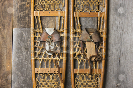 Antique Snowshoes on Rustic Cabin Wall stock photo, Antique Snowshoes on Rustic Cabin Wall by Andy Dean