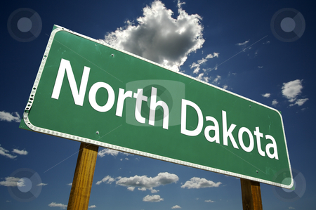 North Dakota Road Sign stock photo, North Dakota Road Sign with dramatic clouds and sky. by Andy Dean