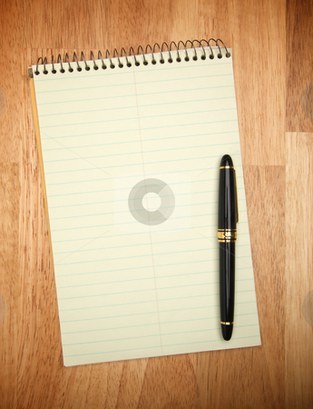 Pad of Paper & Pen stock photo, Pad of Paper & Pen on a wood background. by Andy Dean