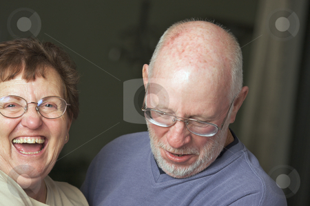 Happy Senior Adult Couple stock photo, Happy Senior Adult Couple Laughing by Andy Dean