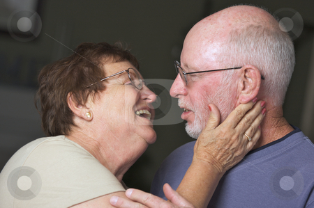 Happy Senior Adult Couple stock photo, Happy Senior Adult Couple Facing Each Other by Andy Dean