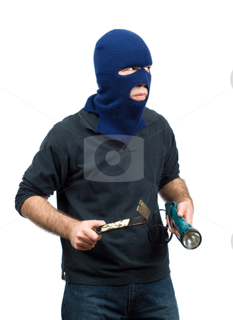 Home Burglary stock photo, A home burglar isolated against a white background, holding a flashlight and a crowbar by Richard Nelson