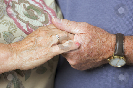 Senior Adult Couple Holding Hands stock photo, Happy Senior Adult Couple Holding Hands by Andy Dean
