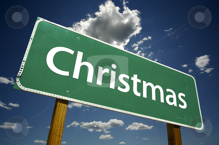 Christmas Road Sign with Dramatic Clouds stock photo, Christmas Road Sign with dramatic clouds and sky. by Andy Dean