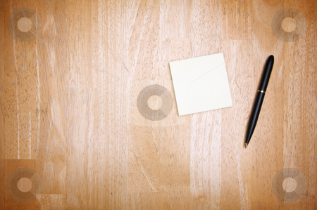 Pen and Post It Notes stock photo, Pen and Post It Notes Pad Against a Wood Background by Andy Dean