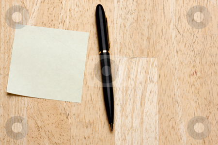 Pen and Post It Notes Pad stock photo, Pen and Post It Notes Pad Against a Wood Background by Andy Dean