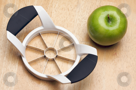 Apple and Slicer stock photo, Apple and Slicer on a Wood Background by Andy Dean