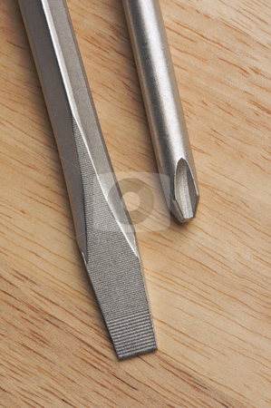 Pair of Screwdrivers stock photo, Pair of Screwdrivers on a Wood Background by Andy Dean