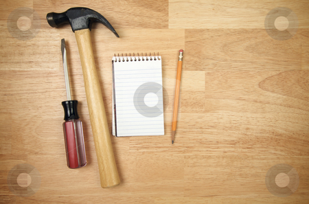 Pad of Paper, Pencil, Hammer and Screwdriver stock photo, Pad of Paper, Pencil, Hammer and Screwdriver on a Wood Background. by Andy Dean