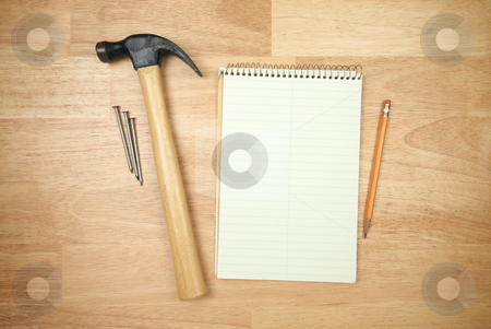 Pad of Paper, Pencil, Hammer and Nails stock photo, Pad of Paper, Pencil, Hammer and Nails on a Wood Background. by Andy Dean