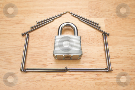 House of Nails with Lock stock photo, House of Nails with Lock on a Wood Background. by Andy Dean