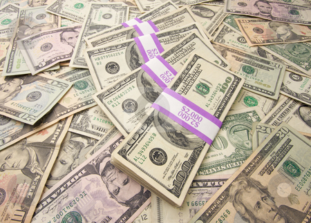 Stack of Money stock photo, Stacks of Unites States Money Background - Contains Recent Currency Designs. by Andy Dean