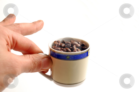 Coffee beans cup stock photo, Cup of coffee beans on white background by Francesco Perre