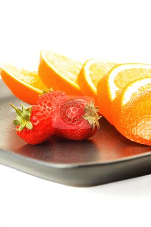 Orange & strawberries stock photo, Orange & strawberries on a plate on white background by Francesco Perre