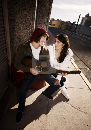 Musician and Pretty Girlfriend Downtown stock photo, Hispanic musician and Latina Girlfriend downtown at sundown by Scott Griessel