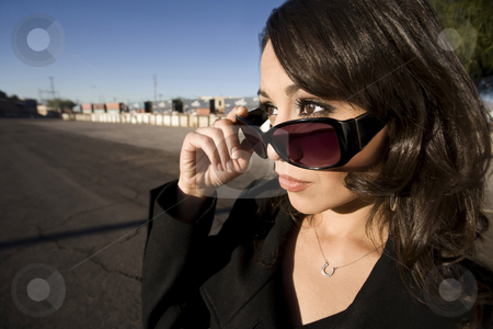 Pretty Hispanic Woman stock photo, Pretty Hispanic woman with dark sunglasses in an urban setting by Scott Griessel