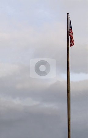 United States Flag On Flagpole stock photo, The flag of the United States of America hanging on a flagpole. by Kathy Piper