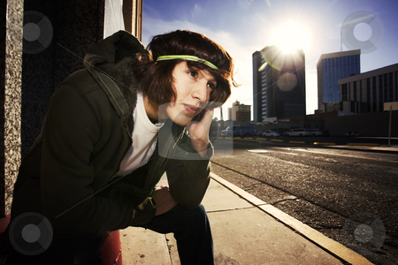 Handsome young man at sundown in city stock photo, Handsome young man at sundown in an urban setting by Scott Griessel