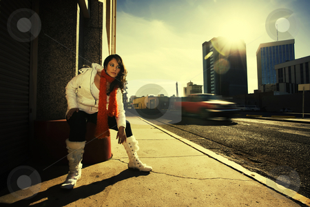 Pretty woman at sundown in city stock photo, Pretty Hispanic woman at sundown in an urban setting by Scott Griessel