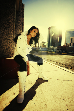Pretty woman at sundown in city stock photo, Pretty Hispanic woman at sundown in an urban setting by Scott Griessel