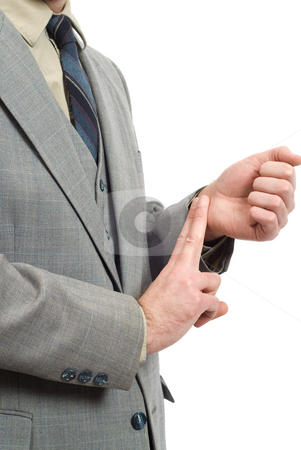 Businessman Checking His Pulse stock photo, A businessman wearing a grey suit, checking his radial pulse with his fingers by Richard Nelson