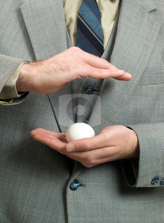 New Business stock photo, Concept of a businessman trying to protect his new business by Richard Nelson