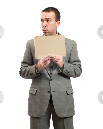 Worried Businessman  stock photo, A worried businessman holding a blank cardboard sign, isolated against a white background by Richard Nelson