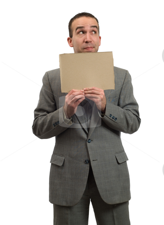Hopeful Businessman stock photo, A young businessman hopeful about the economy is holding a blank cardboard sign, isolated against a white background by Richard Nelson