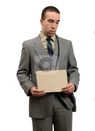 Jobless Businessman stock photo, A jobless businessman holding a blank cardboard sign, isolated against a white background by Richard Nelson