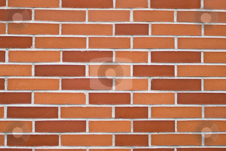 Brickwall stock photo, A brickwall with stones in shades of red and orange by Alexander L?