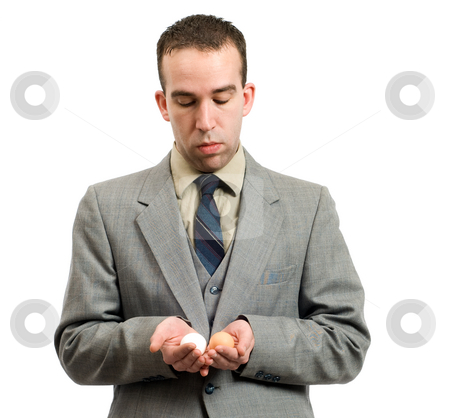 Business Plan stock photo, Businessman using white and brown eggs to help him compare business plans by Richard Nelson