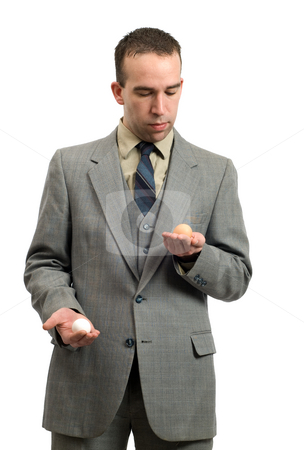 Pros and Cons stock photo, Concept image of a businessman using his hands to weigh the pros and cons by Richard Nelson