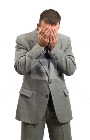 Crying Businessman stock photo, A businessman man crying into his hands, isolated against a white background by Richard Nelson
