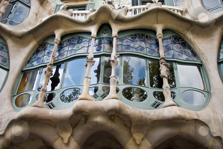 Window of casa batllo stock photo, A detail of a window of casa battlo styled by antonio gaudi by Alexander L?
