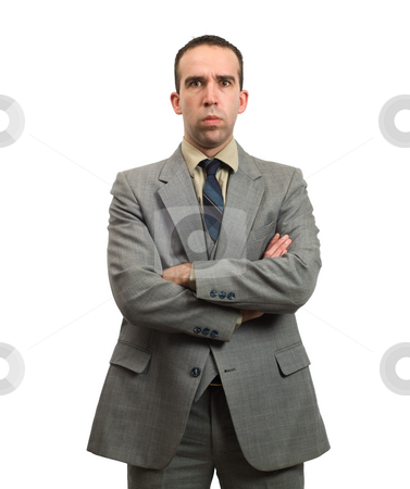 Stern Businessman stock photo, A young businessman with his arms crossed is giving a stern look by Richard Nelson