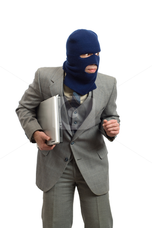 Sneaky Thief stock photo, A sneaky thief is stealing a new computer, isolated against a white background by Richard Nelson