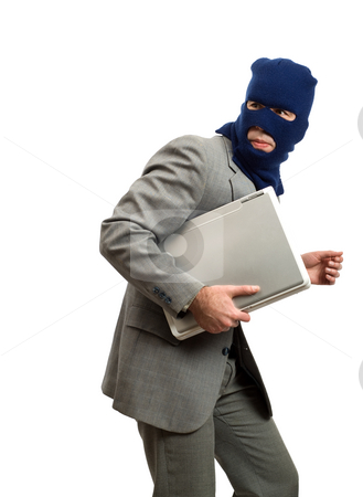 Thief Getting Away stock photo, A computer thief is getting away with a laptop by Richard Nelson