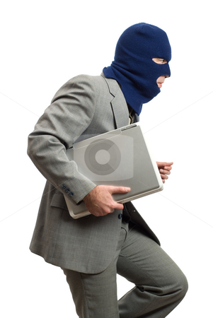 Computer Thief stock photo, A computer thief with a balaclava by Richard Nelson