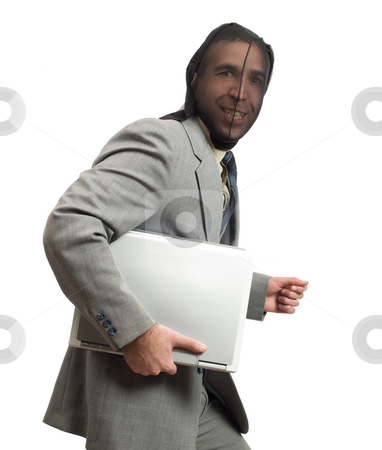 Company Information stock photo, Businessman thinks he got away with stealing company information on a laptop by Richard Nelson