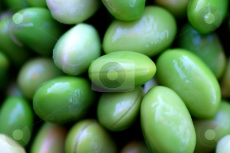 Edamames stock photo, Group of bright green edamame soy beans. by Henrik Lehnerer